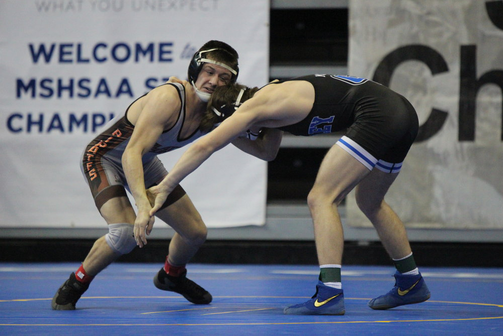 Platte County's Nick Filger, left, battles Grain Valley's Mitchell Alexander in the consolation bracket of the 138-pound weight class at MSHSAA State Wrestling Championships on Friday, Feb. 16 in Columbia, Mo.