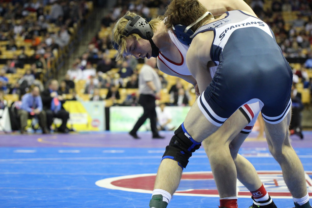 CODY THORN/Citizen photo Park Hill's Josh Steele, left, tries to escape the grasp of Francis Howell Central's Corey Wait in the Class 4 145-pound class championship on Saturday, Feb. 17, at Mizzou Arena.