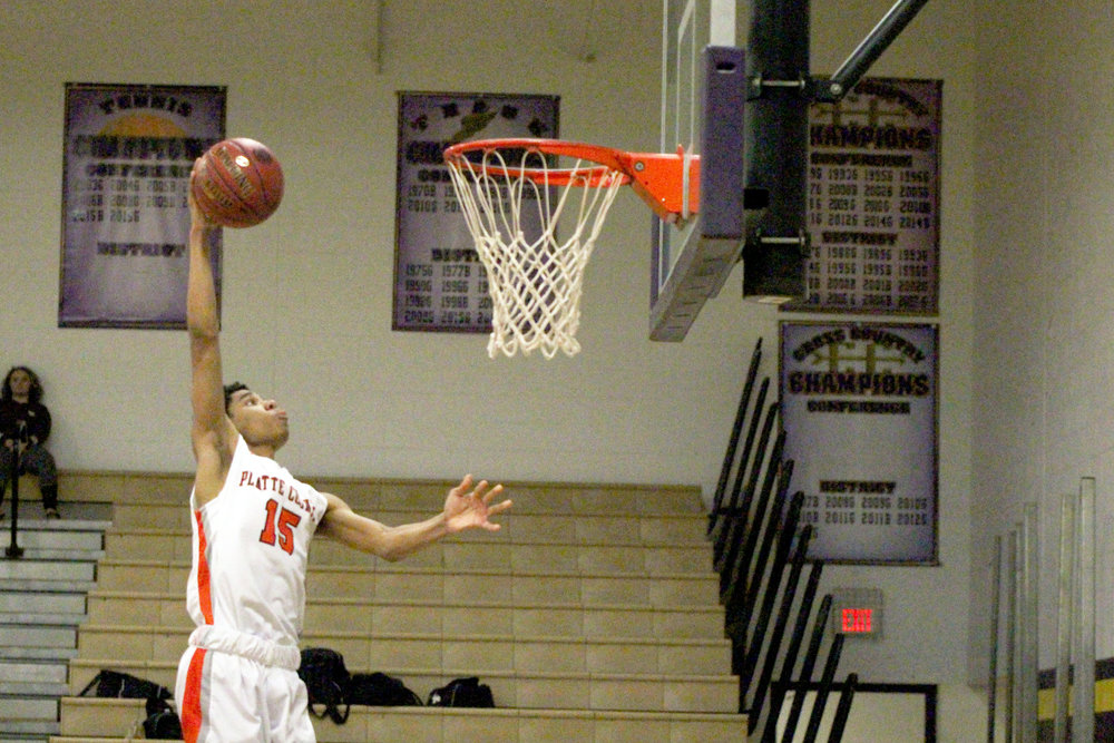 Cody Thorn/Citizen photo Platte County senior Deiondre Ragsdale skies for a dunk during Monday night's game against Excelsior Springs in the Class 4 District 16 Tournament in Kearney, Mo. Ragsdale helped Platte County cruise to a 75-48 victory in the first-round matchup.