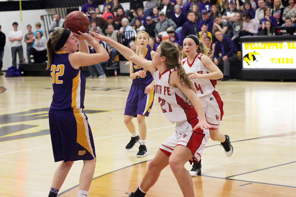 Cody Thorn/Citizen photo North Platte's Grace Rice, left, prepares to shoot while being guarded by Santa Fe's Sadie Limback during a Class 2 District 15 semifinal game held Friday, Feb. 23, at Wellington-Napoleon High School in Wellington, Mo.