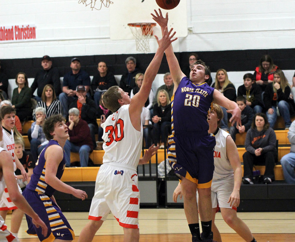 North Platte's Hunter Hendricks goes up for a layup in front of Concordia's Lane Mueller during Friday's game in the Class 2 District 15 semifinals. North Platte lost 60-48.