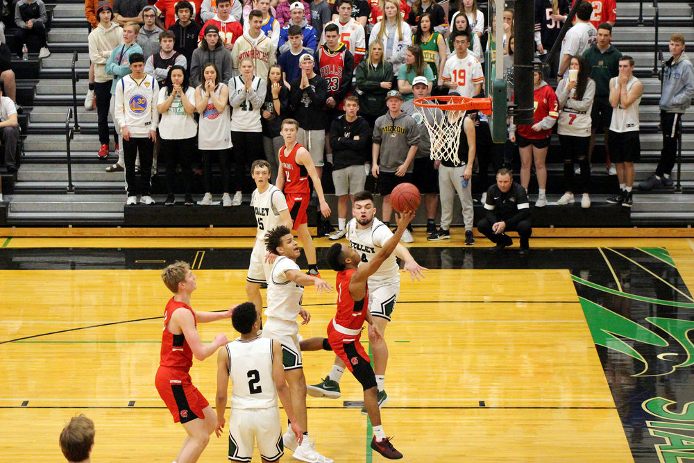 CODY THORN/Citizen photo Park Hill's DeShaun Powell, center, goes up for a layup between a pair of Staley defenders during a Class 5 District 16 semifinal game on Thursday, March 1 at Staley High School in Kansas City.