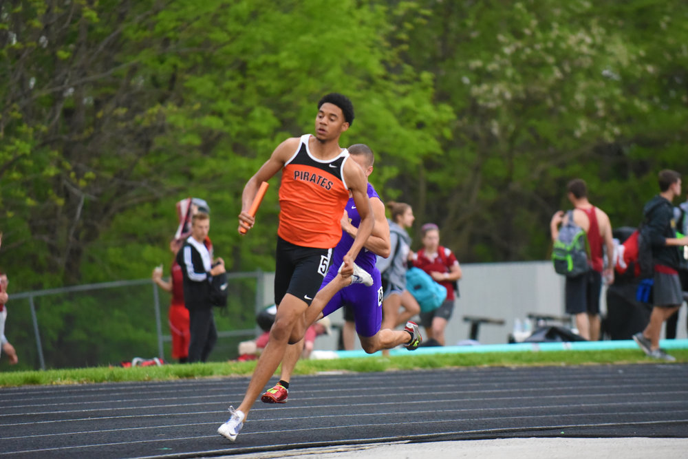 John Watts runs a relay event for Platte County during a meet last season. He is one of handful of returning medalists for the Pirates.