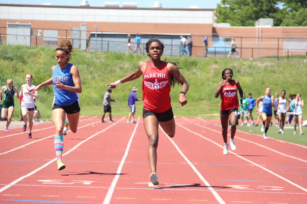 Citizen file photo Park Hill's Taiya Shelby, center, is one of the key returning members for the Trojans this spring. She was part of Park Hill's Class 5 state champion 4x400-meter relay team last spring.
