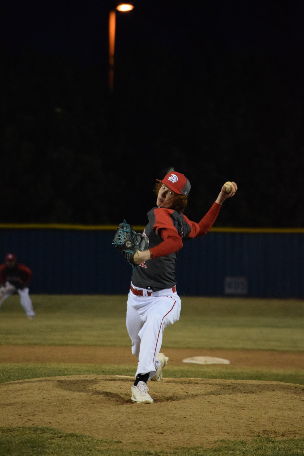 BRYCE MERENESS/Citizen photo Park Hill's Chandler Ashby delivers a pitch in a game against Kearney on Friday, March 16, at Liberty High School. The Trojans won the game 9-5.