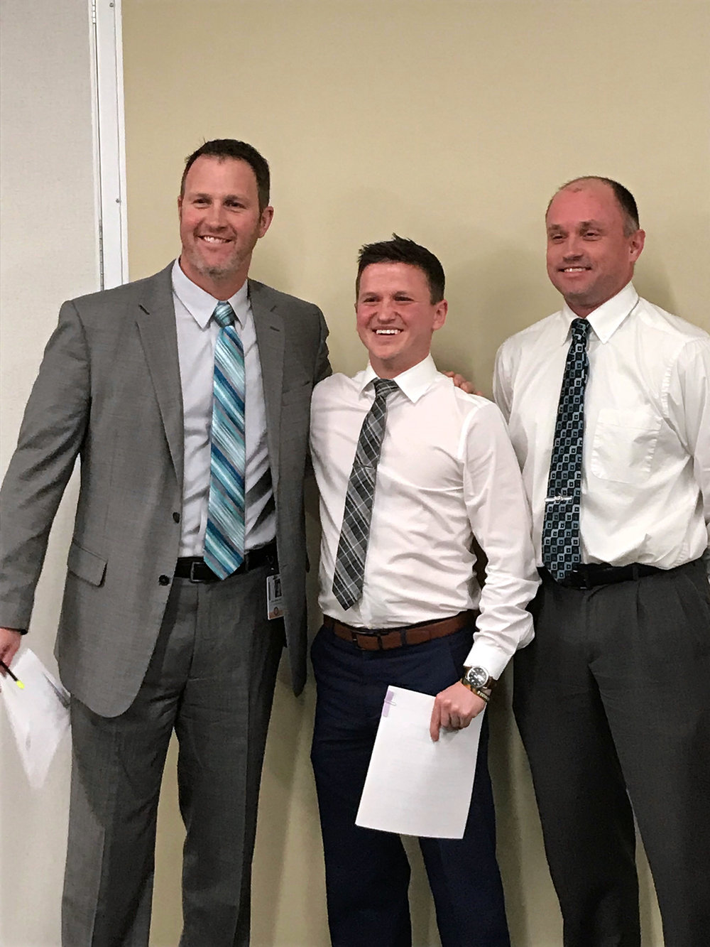 BRYCE MERENESS/Citizen Staff Pathfinder Elementry physical education teacher Joe Masciovecchio, center, was honored as the March SCHIVIR Me Timbers recipient. Joining him is Pathfinder principal Dr. Devin Doll (left) and Andy Hall, director of information services.
