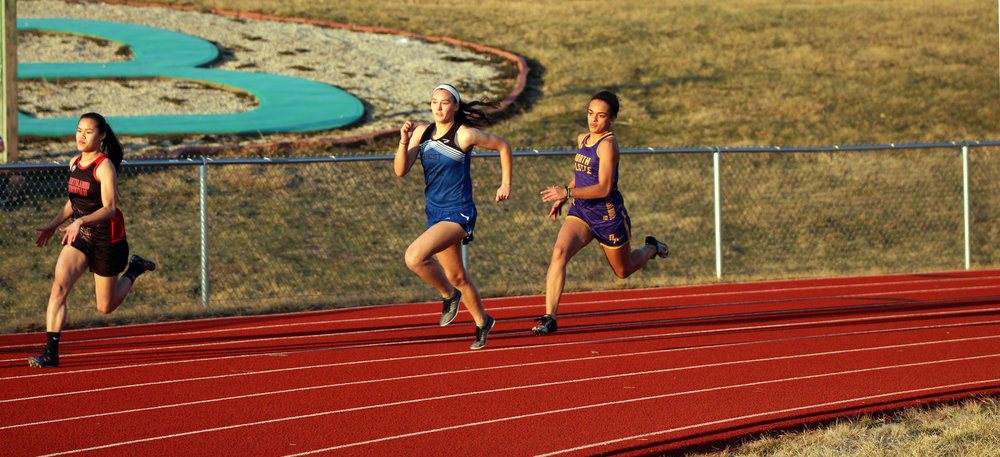 CODY THORN/Citizen photo West Platte's Ciara Davies, second from left, and North Platte's Maddie O'Neill compete in the 200-meter dash at the Mid-Buchanan Early Bird meet held on Thursday, March 22, in Faucett.