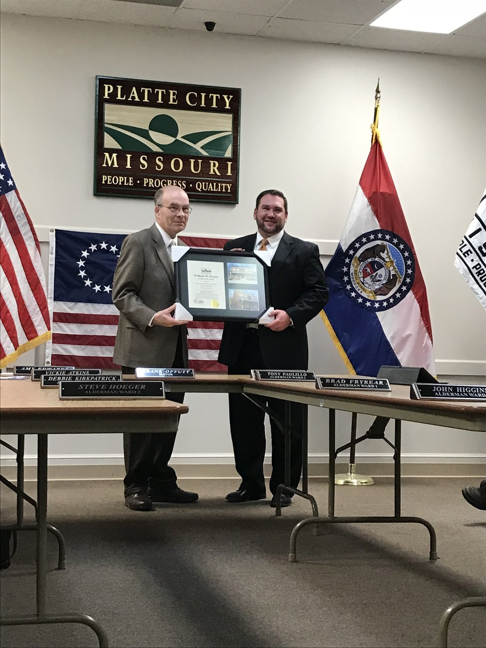 CODY THORN/Citizen photo Platte City mayor Frank Offutt, left, presents a framed photo to Jeremy Webb of Welch and Webb Law Firm during the Platte City Board of Aldermen meeting held on Tuesday, March 27.