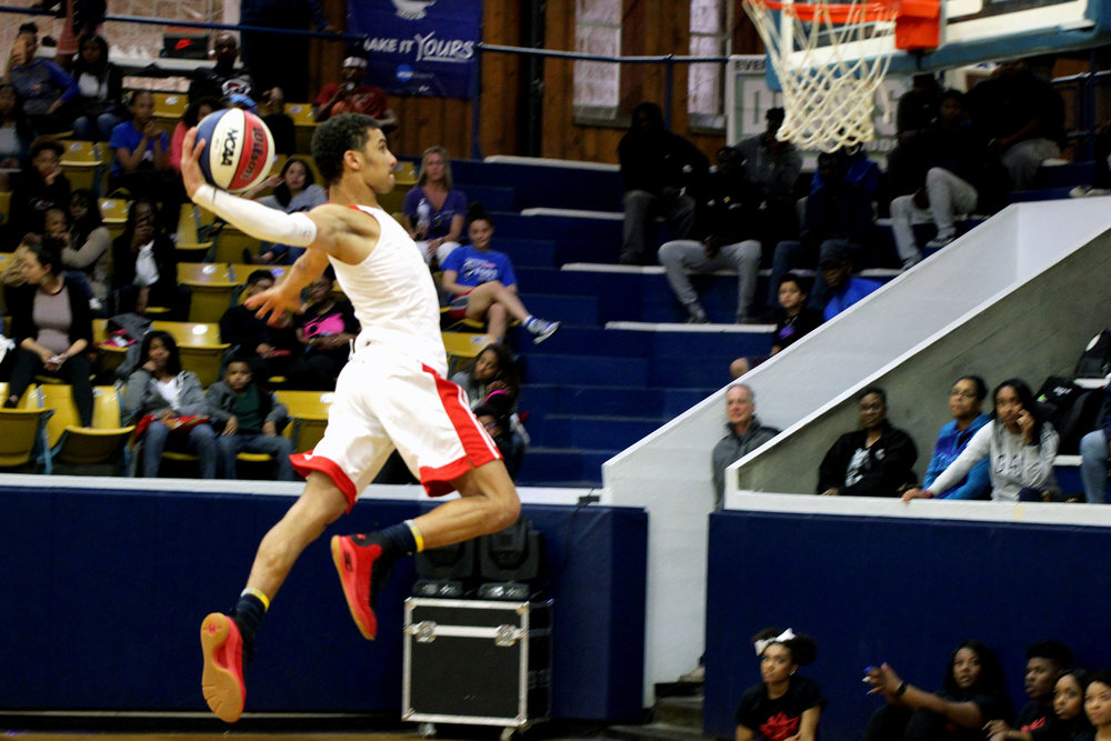 CODY THORN/Citizen photo Park Hill senior Ronnie Bell goes up for a slam during the halftime dunk contest of the Sideline Sports Stateline Showdown on Saturday, March 31 at Rockhurst University in Kansas City, Mo.