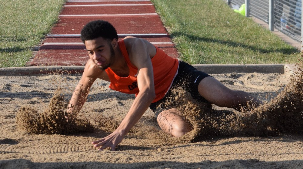 BRYCE MERENESS/Citizen photo Platte County senior John Watts lands in the sand pit after a long jump attemp at the Staley Relays on Friday, March 30 at the North Kansas City District Activities Complex in Kansas City, Mo. Watts, a Missouri Southern signee, won the event with a leap of 21-feet, 3-inches.
