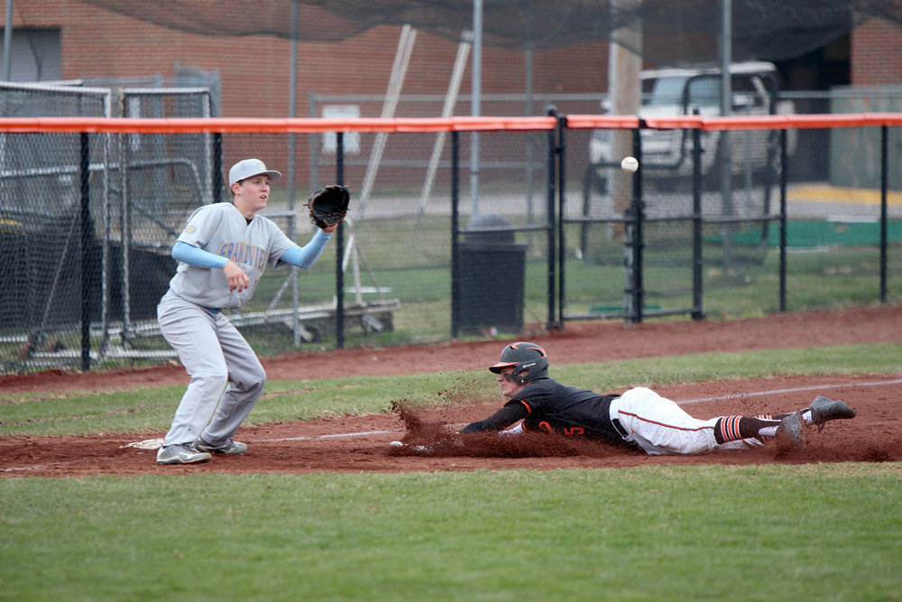 CODY THORN/Citizen photo Platte County's Ethan Esdohr slides into third base on a steal attempt in the Pirates 11-1 win against Grandview on Monday, April 9 at Platte County High School. Esdohr was safe on the play and later scored one of the 11 runs for Platte County.