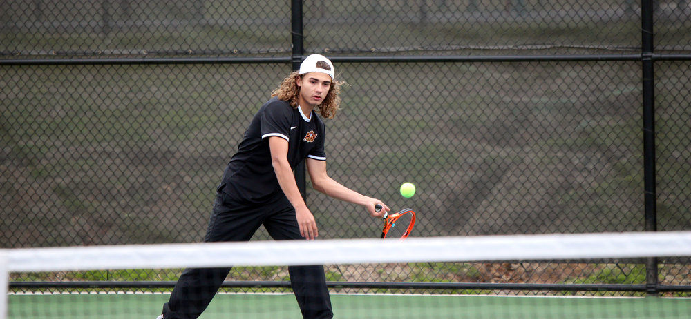 CODY THORN/Citizen photo Platte County's Porter Curtis eyes a return during Platte County's home dual win against Oak Park on Monday, April 9 at the Platte County Tennis Courts in Platte City, Mo.