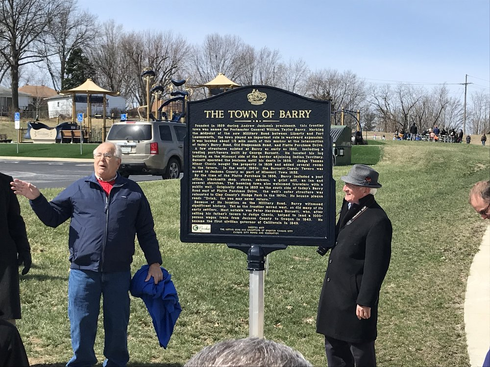 CODY THORN/Citizen photo Local historian Keith Nelson, left, and Ross Marshall, past president and markers chairman for Native Sons and Daughters of Greater Kansas City, talk about the unveiling of the Town of Barry historical marker at the Greg and Shirley Pryor YMCA Challenger Field in Kansas City North, in southern Platte County. The Town of Barry marker is one of three unveiled at the ceremony which honored the area's history in the early 1800s.