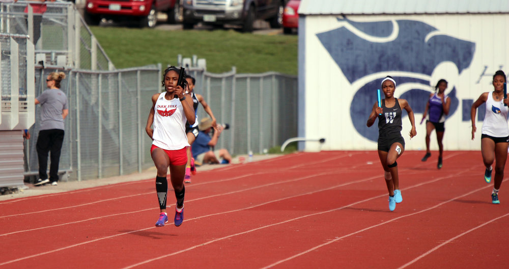 Park Hill's Taiya Shelby leaves the pack behind in the 4x200-meter relay race at the Gary Parker Invitational on Thursday, April 12, in Blue Springs, Mo.