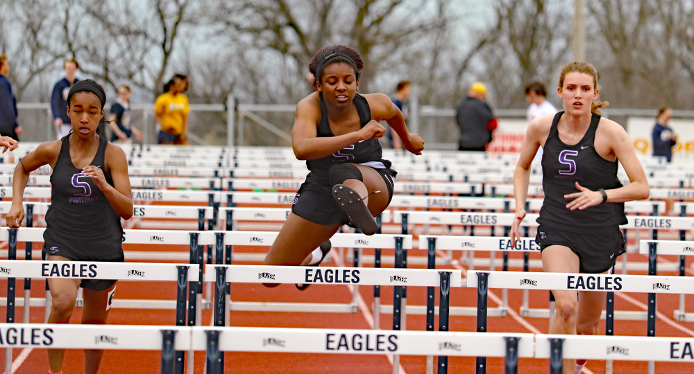 THOM HANRAHAN/Special to the Citizen Park Hill South's Ally Hammond, left, Dymeria Guillory, center, and Mara Andrews, right, compete in the 100-meter hurdles during the Liberty North Invitational. Guillory won the race, while Hammond was third and Andrews was fourth.