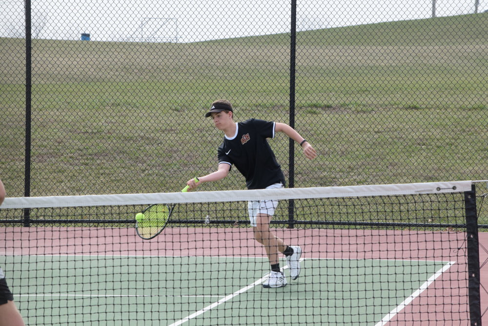 BRYCE MERENESS/Citizen photo Platte County's Isaac Cook returns a volley during the Excelsior Springs Tournament on Wednesday, April 11, in Excelsior Springs, Mo.