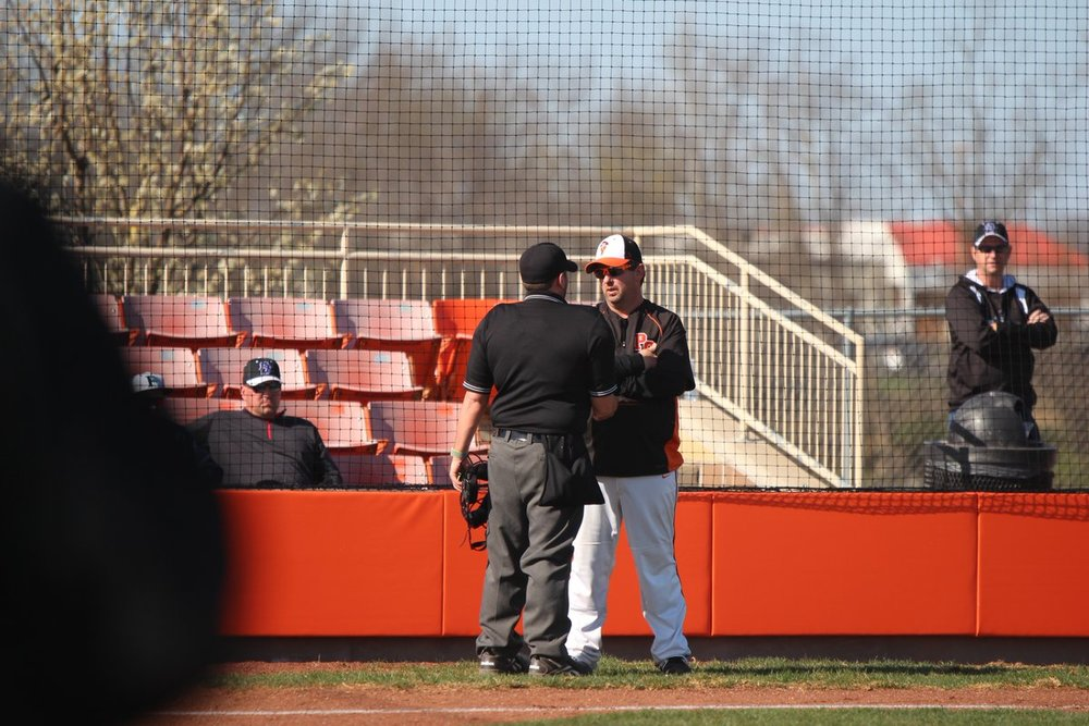 CODY THORN/Citizen photo Platte County coach Rob Davenport talks to an umpire about a call during a game on Thursday April 19, against Park Hill South.