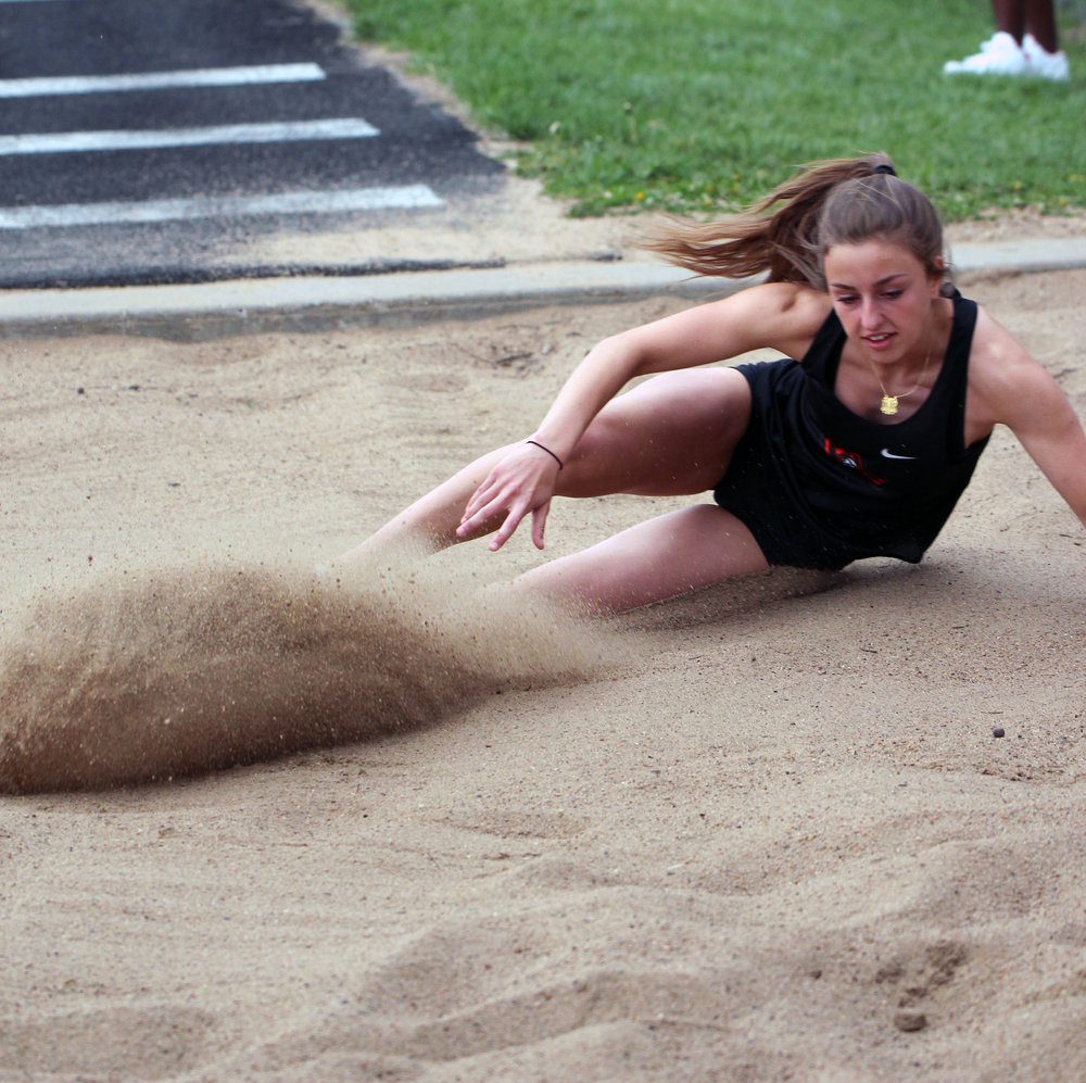 Platte County's Karleigh Wise lands in a sand pit during the long jump at the Platte County Invitational on Tuesday, April 24 at Pirate Stadium.