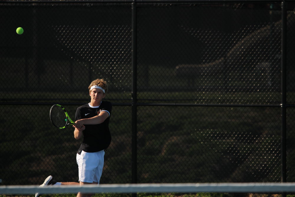 CODY THORN/Citizen photo Platte County's Nathen Mair watches a return in the Pirates dual against Kearney on Monday, April 30 at the Platte County Tennis Courts in Platte City, Mo.