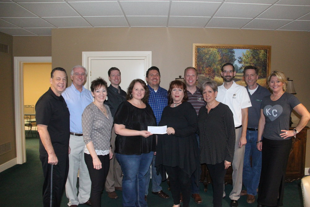 CODY THORN/Citizen photo Members of the Parkville Area Chamber of Commerce recently presented a more than $15,000 check to Synergy Services, which is headquartered in Parkville, as the chamber's 2017 charity of choice. Fundraisers for charities of choice are held throughout the year.