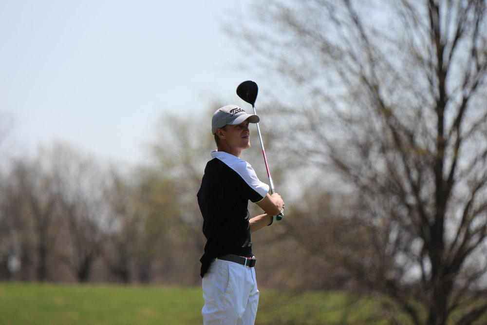 CODY THORN/Citizen photo Park Hill junior Ryan Graves watches a Tee shot at the Class 4 district 8 tournament on the Posse Course of the Paradise Pointe Golf Complex in Smithville, Mo.