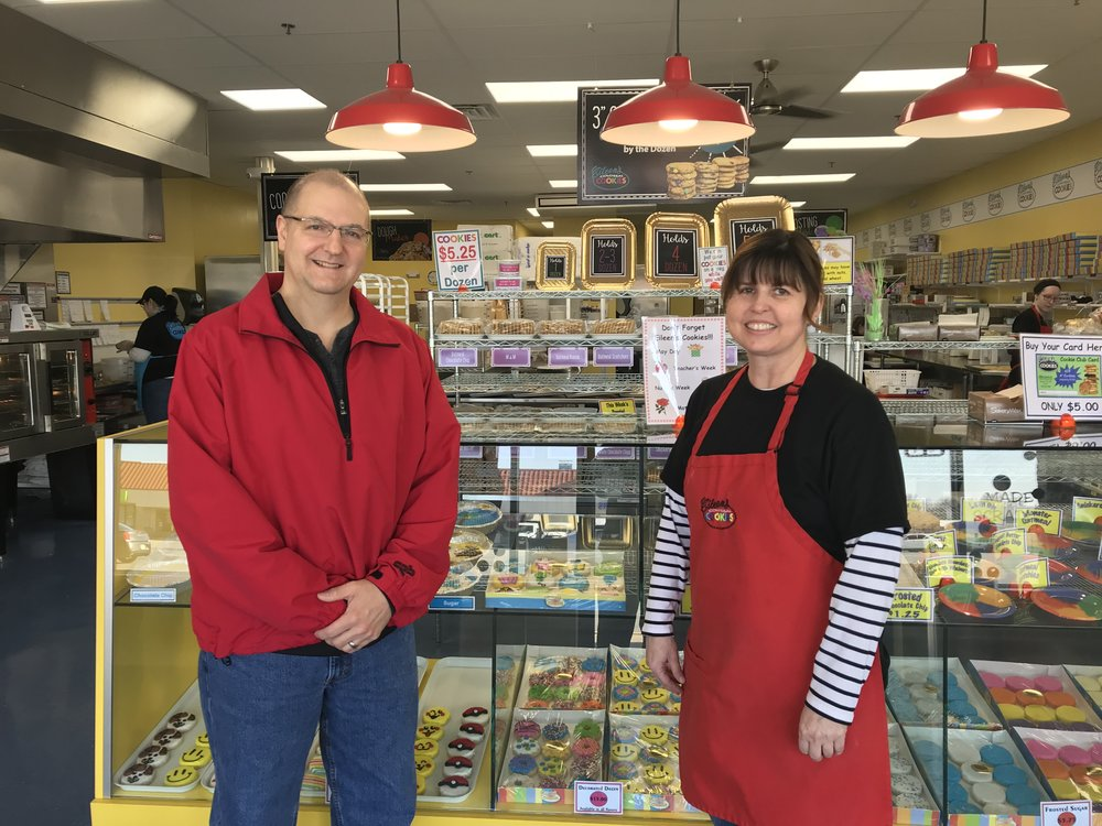 CODY THORN/Citizen photo Lewis and Denise Carpenter recently opened an Eileen's Colossal Cookie franchise in a shopping center at Interstate 29 and NW Barry road in Kansas City North.