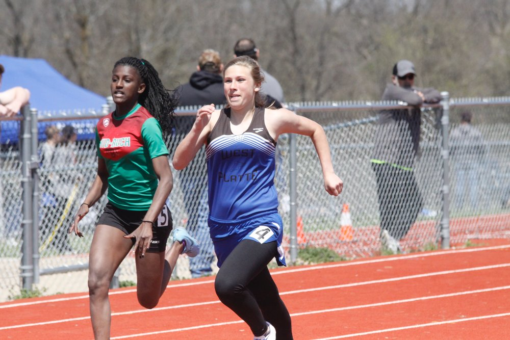Clinton County Leader/Special to the Citizen West Platte's Sarah Stalcup, right, runs in the 200-meter dash at the KCI Conference Track and Field Championships on Saturday, April 28 at Mid-Buchanan High School in Faucett, Mo.