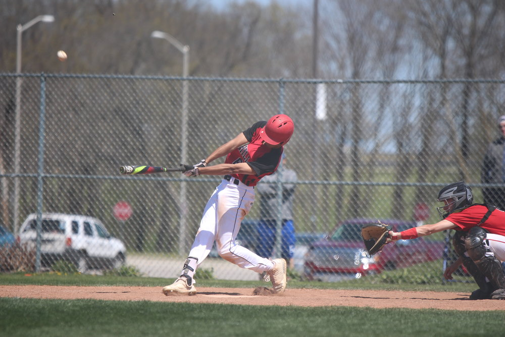 Park Hill senior Liam Henry lines a pitch in the Trojans'  doubleheader vs. Fort Osage  on Saturday,. April 28 at Park Hill High School in Kansas City, Mo. The Trojans swept the twinbill with 32 combined runs.