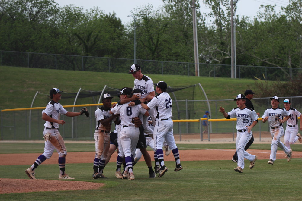 CODY THORN/Citizen photo Park Hill South celebrates on the mound following a 6-4 win against Staley on Monday, May 14 at Park Hill South High School in Riverside, Mo. The Panthers upset the top-seeded district team and No. 2 in the latest poll to move on to the district title game set for Wednesday, May 16