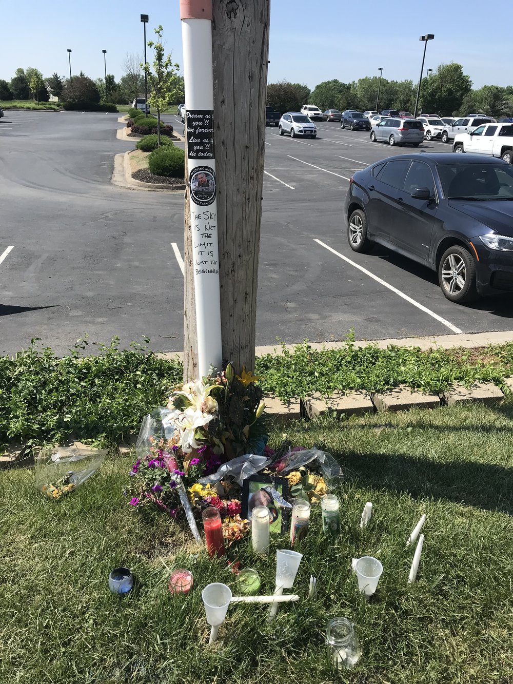 CODY THORN/Citizen photo A makeshift memorial has been made just outside of the Savers parking lot where Russell Fisk crashed his car after being shot. He died of his wounds and on Monday, May 21, Arnoldo Pompa-Rascon was charged with murder in Platte County.