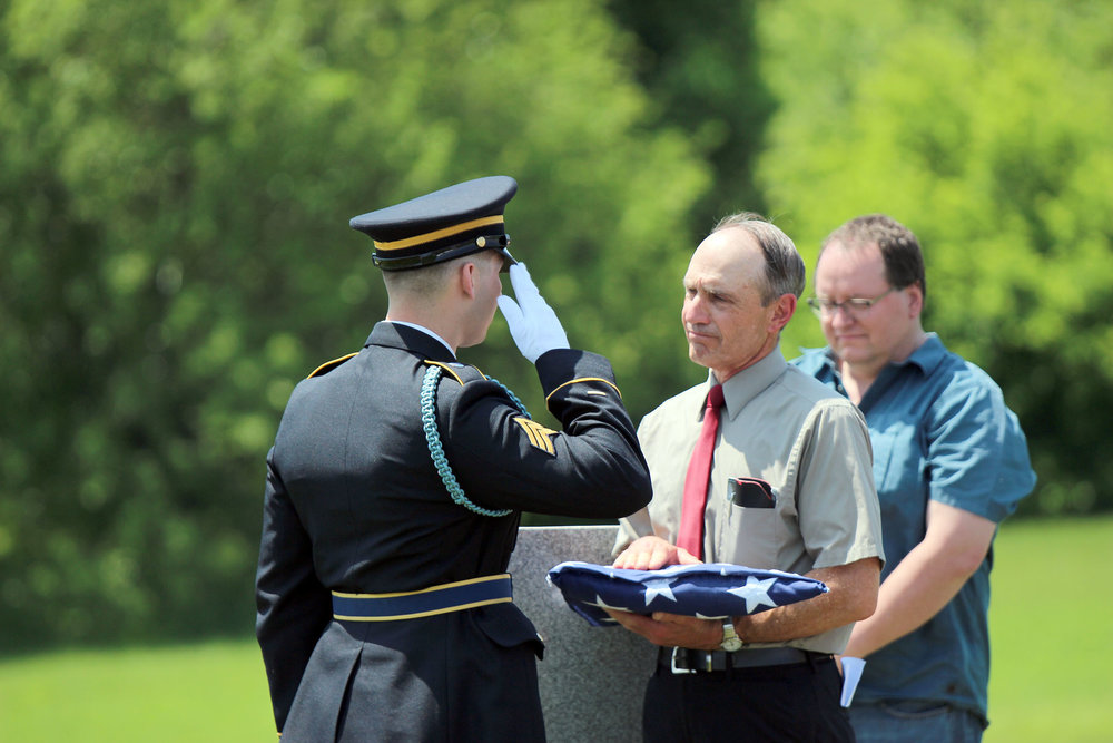 CODY THORN/Citizen photo Camden Point resident Myron Anderson, right, receives a flag during a ceremony held on Tuesday, May 22, in honor of a distant relative, David Christopher Leavel, Jr., who died during World War I.