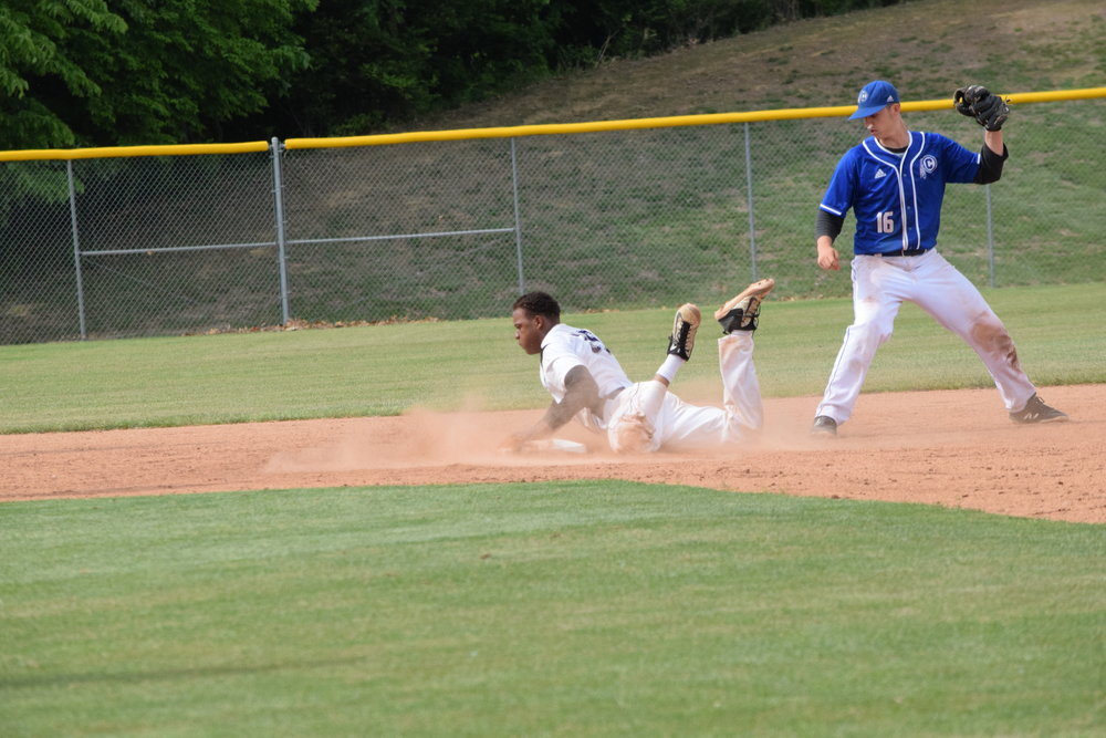 BRYCE MERENESS/Citizen photo Park Hill South catcher Kriss Davis, left, slides into second base before St. Joseph Central shortstop Samson Holcomb can apply a tag during the Class 5 District 16 district championship game on Wednesday, May 16, at Park Hill South High School in Riverside, Mo.