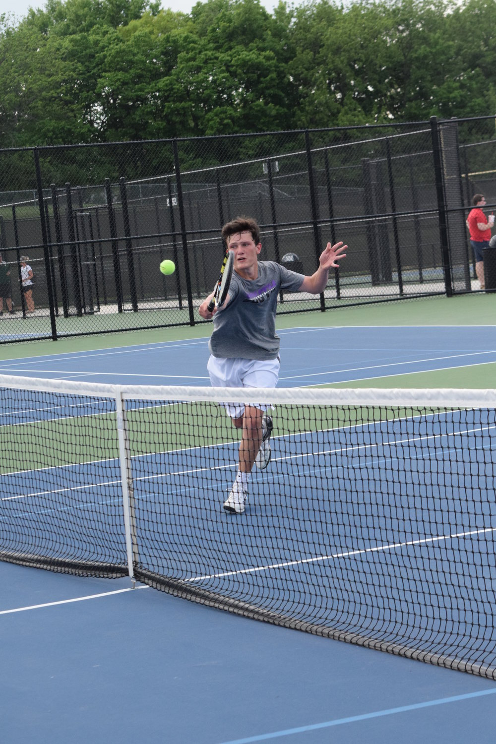 BRYCE MERENESS/Citizen photo Park Hill South's Andrew Robaska gets to the net to return a volley during the Class 2 Sectional 8 on Tuesday, May 15, at the Platte County High School tennis courts. Robaska and doubles teammate Cooper Hayes won and will go the the state finals.