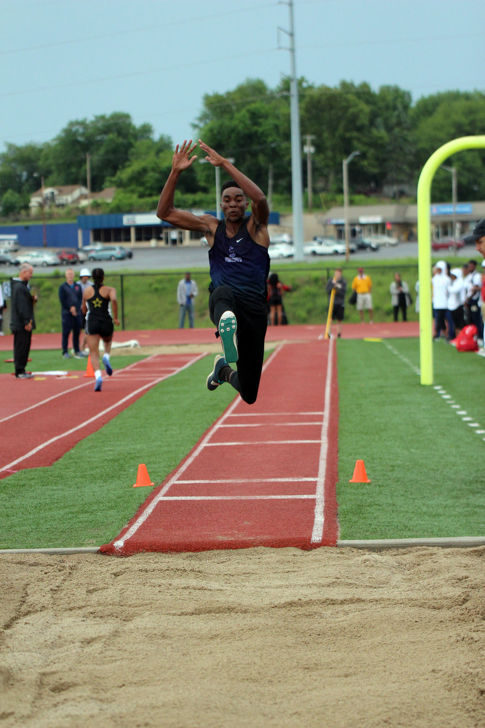 CODY THORN/Citizen photo Park Hill South's Benjamin Owere skies during the triple jump during the Class 5 Sectional 4 meet on Saturday, May 19, at William Chrisman High School in Independence, Mo.