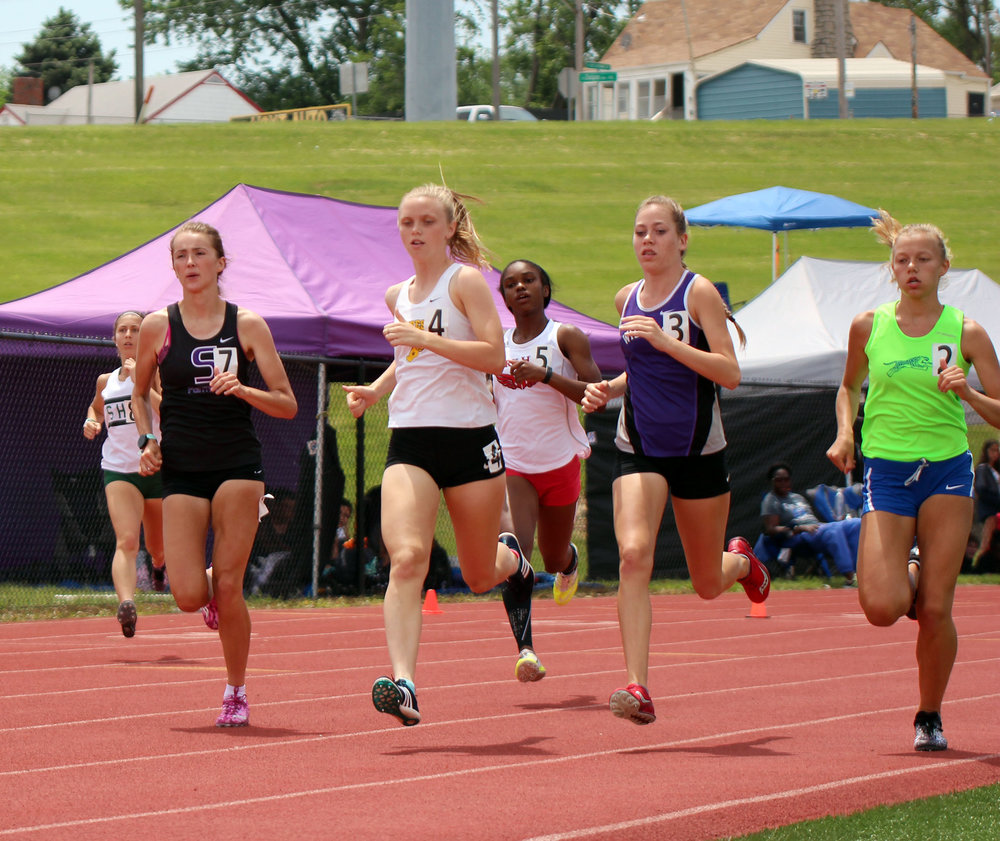 CODY THORN/Citizen photo Park Hill South's Emma Roth, far left, keeps up with the front of the pack in the 800-meter run during the Class 5 Sectional 4 meet on Saturday, May 19, at William Chrisman High School in Independence, Mo.
