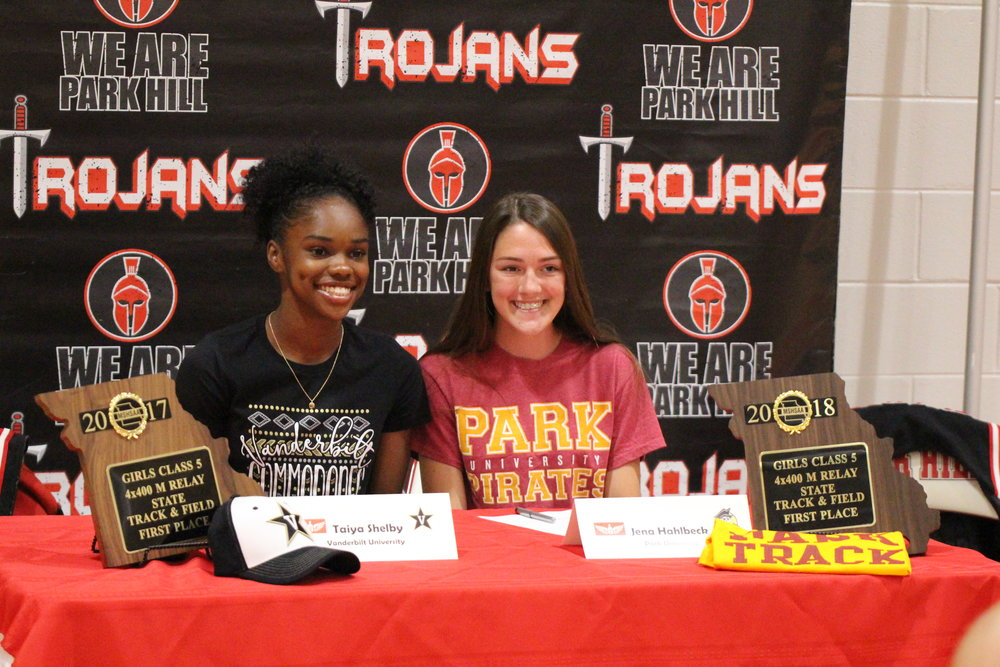 CODY THORN/Citizen photo Park Hill's Taiya Shelby, left, and Jena Hahlbeck held a signing ceremony at the school on Tuesday, May 29. Shelby will run track and field at Vanderbilt University in Nashville, Tenn., while Hahlbeck will join local school Park University. Both were members of the school's 2017 Class 4 4x400-meter relay state championship team.