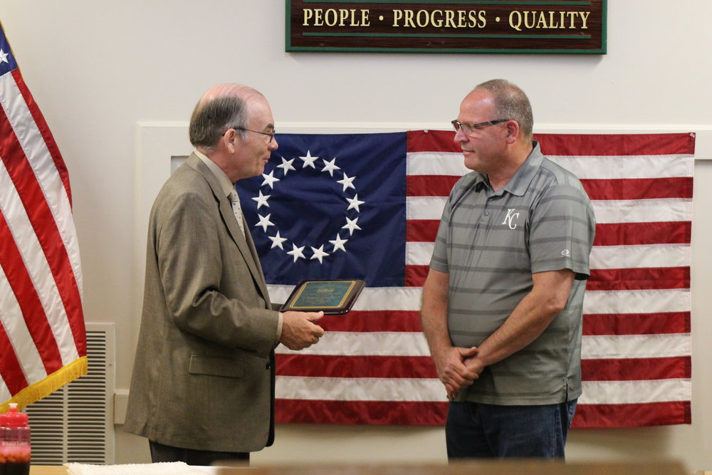 Cody Thorn/Citizen photo Platte City mayor Fank Offutt congratulates city director of public works Leonard Hendricks for his 15-plus years of service.