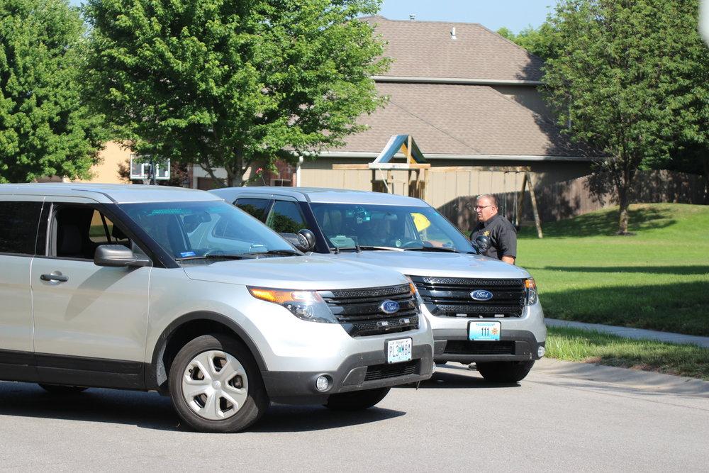 CODY THORN/Citizen photo Platte County Sheriff's Office Sgt. Jeffrey Shanks talks with another deputy near the crime scene where four dead bodies were discovered in the early morning hours of Monday, June 11 in the 14000 block of NW 63rd Street in Parkville.