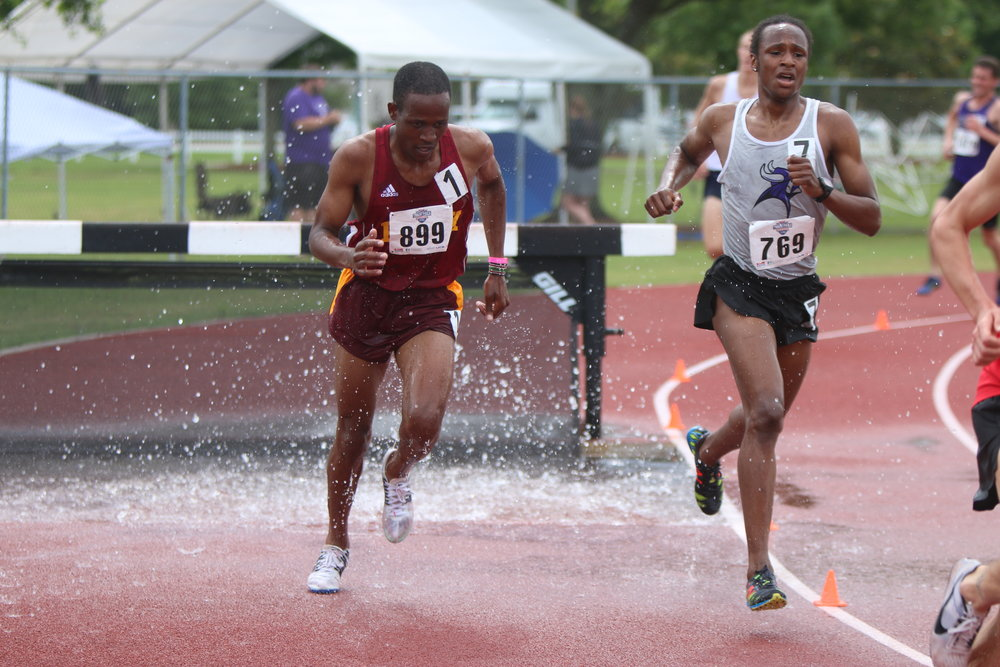 Photo courtesy of Park Athletics Park's Nicholas Rotich, left, took sixth place in the 3,000-meter steeplechase at the NAIA Outdoor Track and Field Championships to earn All-American honors. The junior was one of two to earn that honor for the Pirates.