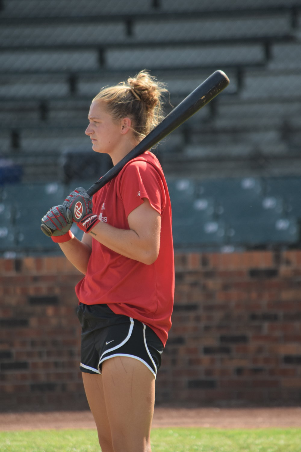 Regan Nash waits her turn for batting practice on Tuesday, prior to her playing in the game. She became the first female in the team history, as well as the M.I.N.K League to appear in a game. The Missouri softball player had an at-bat and played in the outfield during the contest.