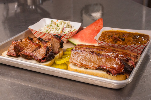 Submitted photo Scott and Dana Umscheid opened Scott's Kitchen and Catering at Hangar 29 on NW Ambassador Drive in central Platte County last year. The company was recently named the best barbecue location in the Kansas City metro area by Travel & Leisure magazine.