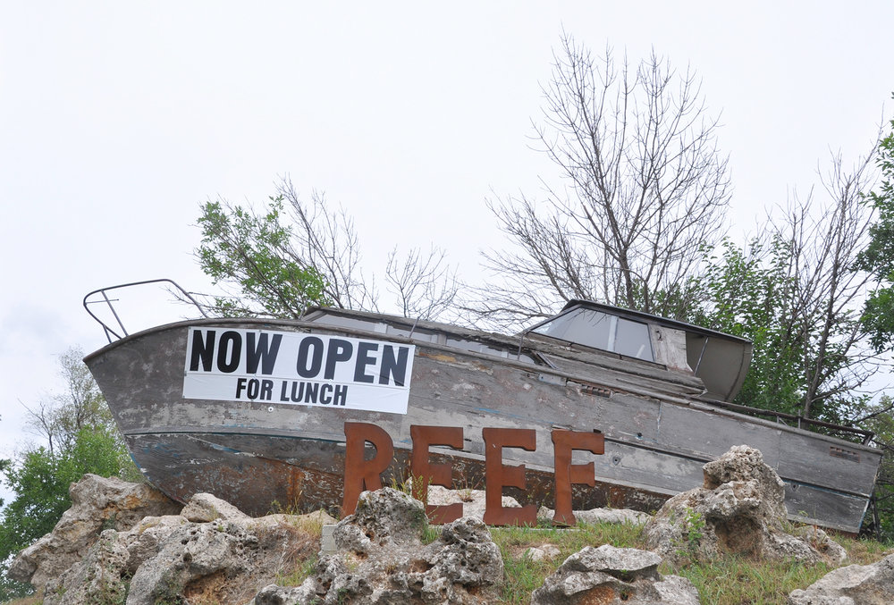 CYNTHIA CLARK/Citizen photo The latest Northland dining experience, The Reef, lures diners from Interstate 29 with its unique sign — a weathered boat. The seafood and steak restaurant recently opened for lunch and the owner plans to open for brunch, happy hour and dinner in the coming months.