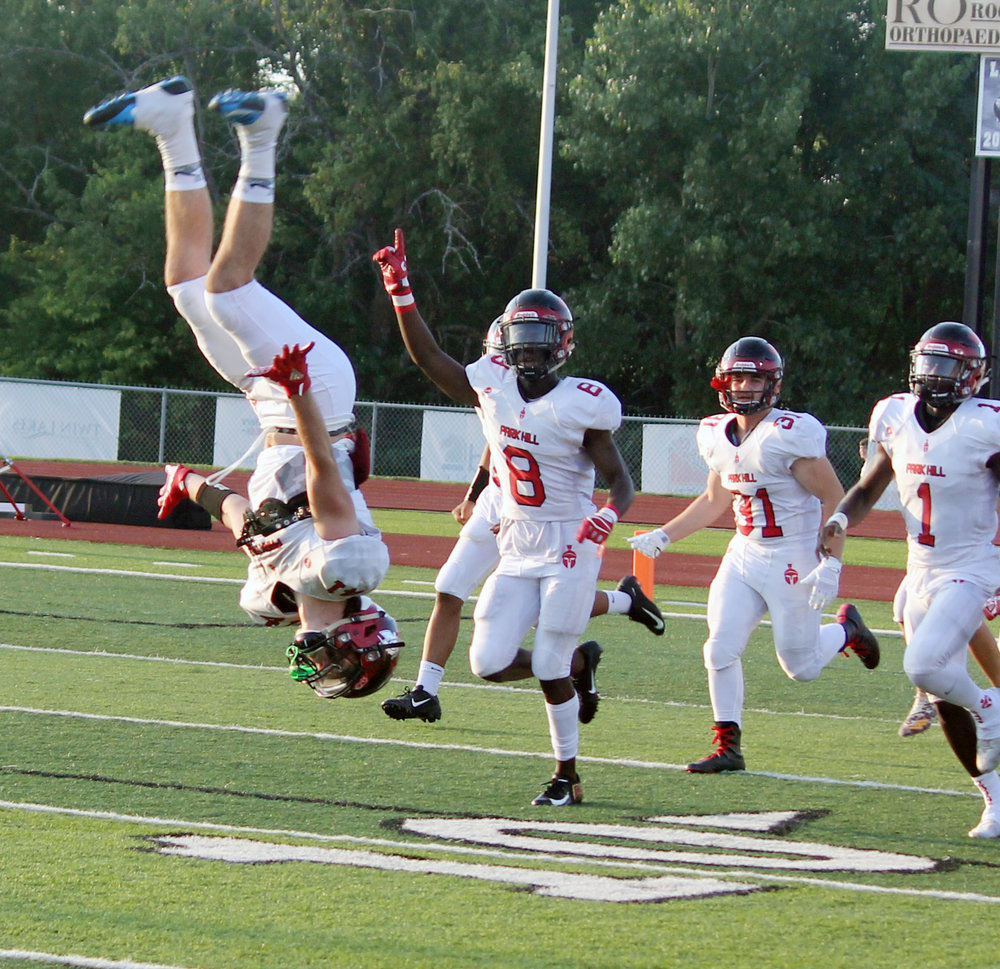JASON LAWRENCE/ Special to the Citizen Park Hill's Carter Goslee does a backflip as the team ran onto the field to play Lee's Summit West on Friday, Aug. 24 in Lee's Summit, Mo.