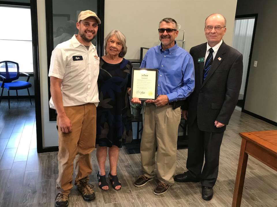 Contributed photo Three generations of the Snyder family — Kyle, Joyce and Dean Snyder — were honored by Platte City mayor Frank Offutt, far right, at Snyder's re-opening celebration earlier this year.