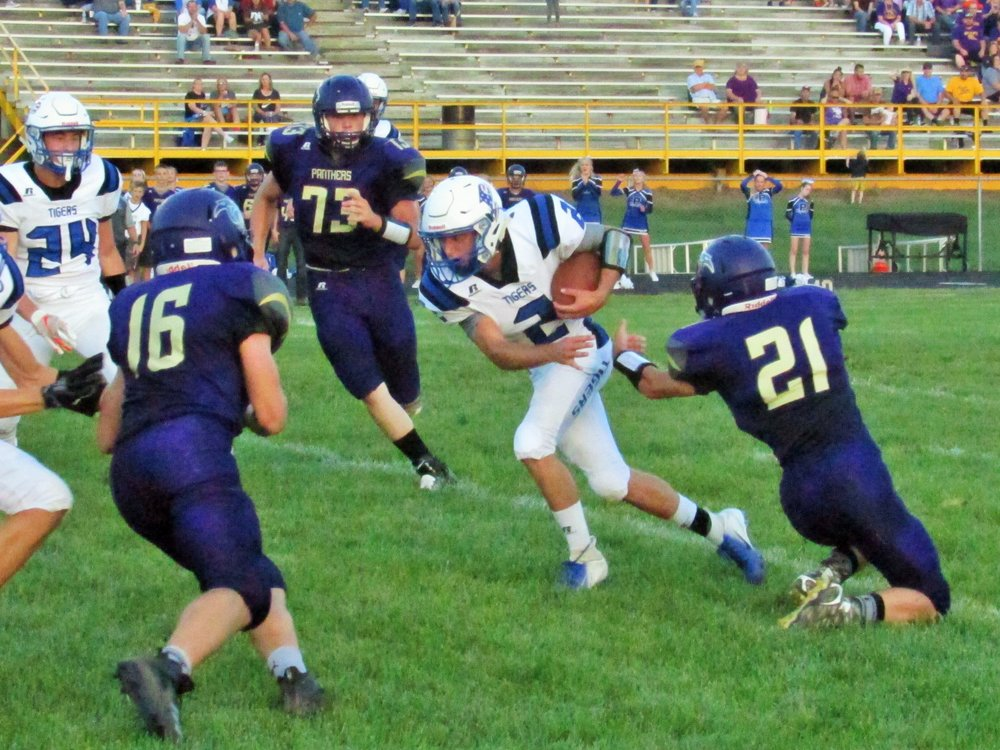 KALEB HUFFMAN/Special to the Citizen ABOVE: Princeton running Logan Dunkin (2) looks to avoid tackles by North Platte's Nelson McCracken (73), Blake Gibson (16) and Joel Smyer (21) during a game on Friday, Aug. 31.