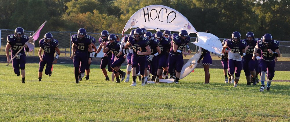 ROSS MARTIN/Special to the Citizen The North Platte Panthers football team runs onto the field during Friday night's homecoming game against Mid-Buchanan in Dearborn, Mo. The Dragons played spoilers by winning 49-0 in a KCI Conference game.