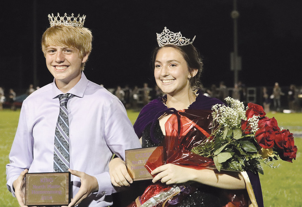 """JEANETTE FAUBION and ROSS MARTIN/Citizen photos North Platte High School in Dearborn held its homecoming parade and game Friday, Sept. 14. Chase Bridger and Kadilynn Kelley, pictured above, were named homecoming king and queen at halftime of the game Friday night. School across the district was dismissed early on Friday to allow participation in the parade, which wound through downtown Dearborn. This year's theme was """"Get Your Game On,"""" with floats decked in board game designs."""