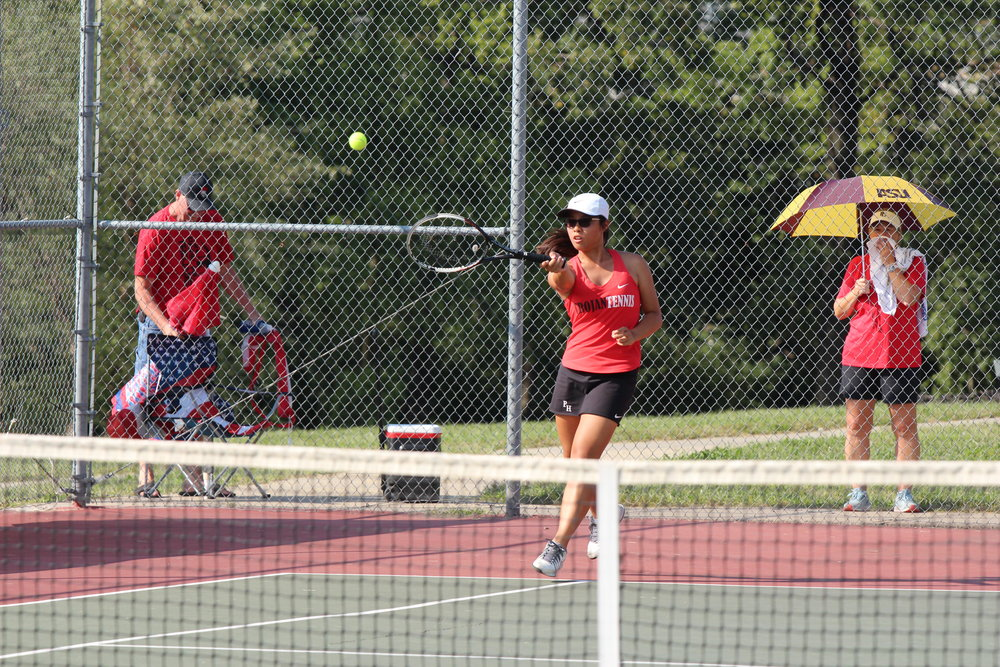 CODY THORN/Citizen photo Park Hill's Grace Yu returns a shot during a double match against Platte County on Monday, Sept. 17 at Barry Park in Kansas City.