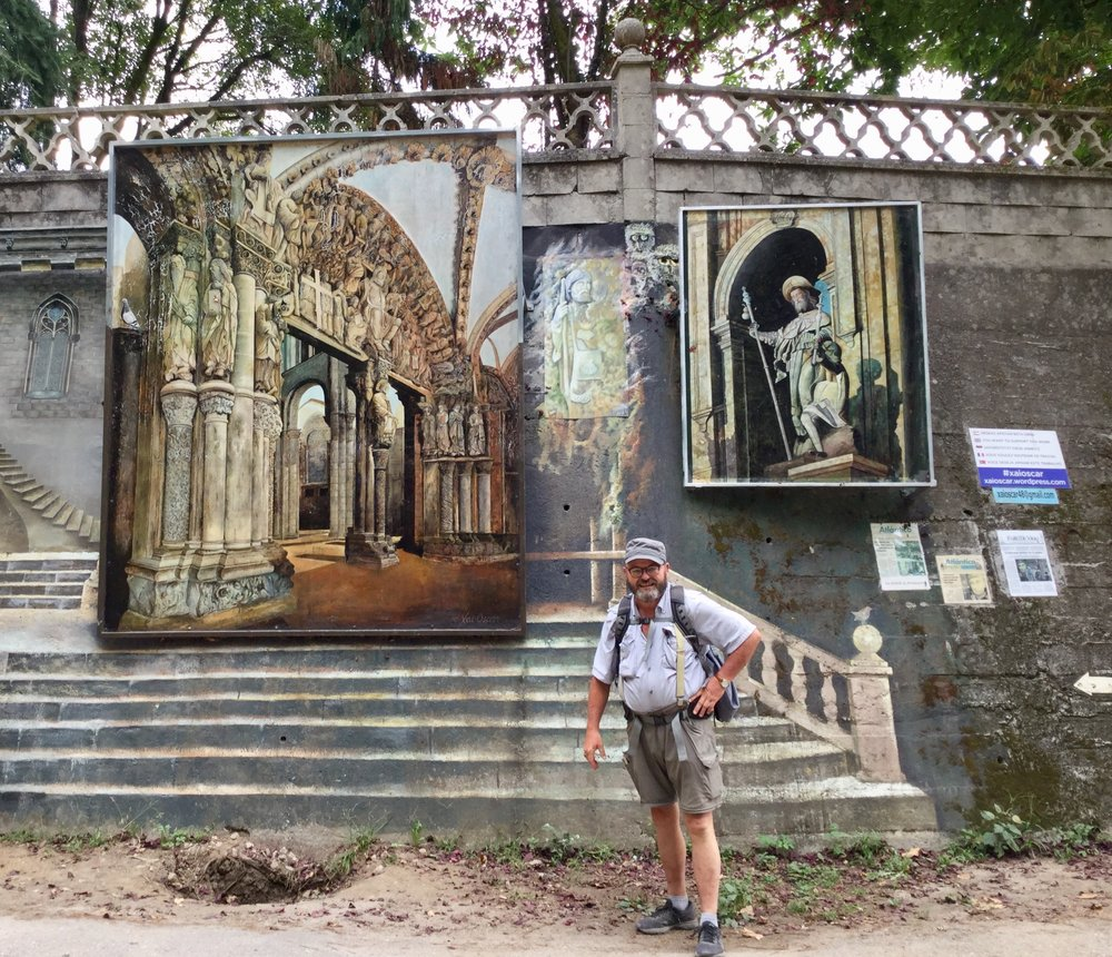 Submitted photo John Larimer of Camden Point stands with the murals at Monte Cornedo, Spain, during his walk on the Camino Portugues.