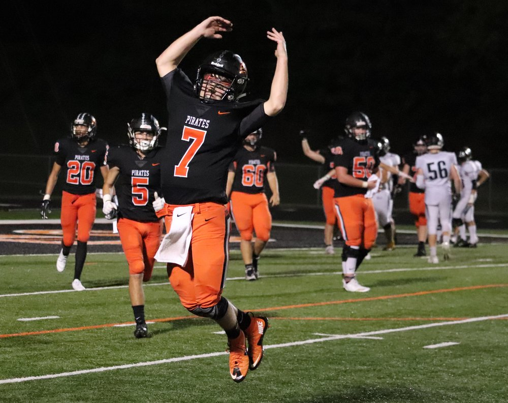 ROSS MARTIN/Special to the Citizen  Platte County quarterback Spencer Stewart, center, celebrates after throwing the game-winning two-point conversion against Ray-Pec on Friday, Oct. 5, helping the Pirates pick up a 36-35 victory against the Class 6 school.